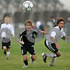 Rob Winner – rwinner@shawmedia.com<br /> <br /> Kaneland's Tyler Siebert (1) and Sycamore's Jacob Bassett (right) chase after a ball during the second half in Sycamore, Ill., on Tuesday, Sept. 27, 2011. Kaneland defeated Sycamore, 2-0.