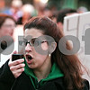 Rob Winner – rwinner@daily-chronicle.com<br /> <br /> Amanda Schrems, sexual assault coordinator for Safe Passage, uses a megaphone as she leads a chant during Take Back the Night in downtown DeKalb on Thursday evening.