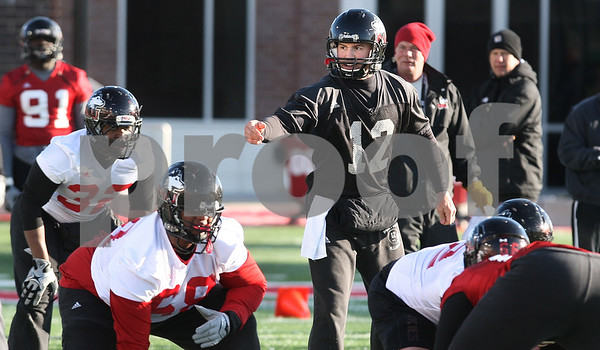 Kyle Bursaw – kbursaw@daily-chronicle.com<br /> <br /> Quarterback Chandler Harnish calls out at the line during practice at Huskie Stadium on Thursday, March 24, 2011.