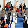 Rob Winner – rwinner@daily-chronicle.com<br /> <br /> Genoa-Kingston's Andrew Oplt watches one of his field goals drop for three during the first half of a home game against Somonauk on Tuesday, Jan. 25, 2011.