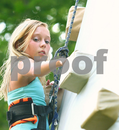 Kyle Bursaw – kbursaw@daily-chronicle.com<br /> <br /> Halea Goad, 10, makes her way up an inflatable climbing wall at Kingston Fest on Saturday, July 16, 2011.
