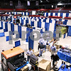 Kyle Bursaw – kbursaw@daily-chronicle.com<br /> <br /> Vendors work on preparing their booths for the Farm show at the Convocation center on Tuesday, Jan. 11, 2011.