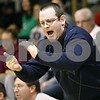 Rob Winner – rwinner@daily-chronicle.com<br /> <br /> Hinckley-Big Rock coach Greg Burks cheers on his team's play on the court during the second quarter.