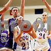 Rob Winner – rwinner@daily-chronicle.com<br /> <br /> Genoa-Kingston guard Rachel Ellstrom tries to get a shot off during the first quarter in Genoa, Ill. on Tuesday, Jan. 4, 2011.