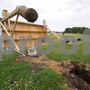 Curtis Clegg – cclegg@shawsuburban.com<br /> <br /> The press box next to the football field at the old DeKalb High School was blown over by heavy winds on the morning of Monday, July 11, 2011. The wind pulled two of the concrete pilings out of the ground.