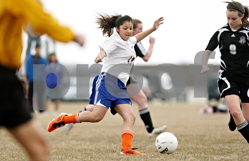 Rob Winner – rwinner@daily-chronicle.com<br /> <br /> Genoa-Kingston's Julia Mendoza moves the ball during the first half. G-K defeated Indian Creek, 5-1.