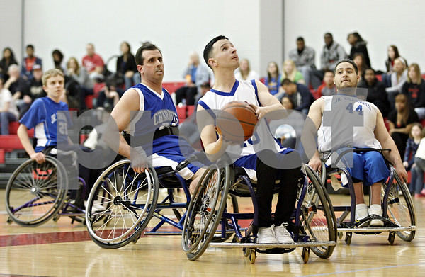 Rob Winner – rwinner@daily-chronicle.com<br /> <br /> Max Dibbin, of the Rockford Chariots wheelchair basketball team, looks to shoot during the first half of an exhibition game at Victor E. Court in DeKalb, Ill. on Thursday, March 31, 2011. The scrimmage was planned by a subcommittee of the Northern Illinois University Presidential Commission on Persons with Disabilities.