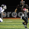 Kyle Bursaw – kbursaw@shawmedia.com<br /> <br /> DeKalb running back Dylan Hottsmith find some room as Rochelle's Justin Myers pursues in the first quarter at DeKalb High School on Friday, Oct. 21, 2011.