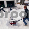 Bill Braksick – bbraksick@daily-chronicle.com<br /> <br /> Brian Cleland, front, Peter Miller, back left, and Justin Johnson team up to dig out Miller's driveway Wednesday afternoon on Second Street in Kingston.