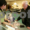 "Rob Winner – rwinner@shawmedia.com<br /> <br /> Server Pamela Schmid (left) helps longtime customer Richard Courtney with his bill at The Lincoln Inn in DeKalb on Thursday afternoon. Courtney, a DeKalb resident donated his reward points to the ""Feed My Starving Children"" program."