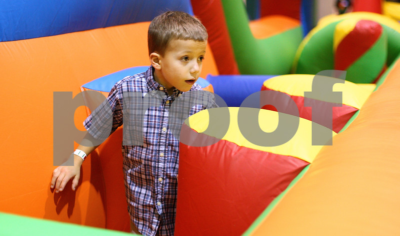 Kyle Bursaw – kbursaw@shawmedia.com<br /> <br /> Ethan Royer, 6, makes his way through one of the inflatable obstacles at 'Jumping Jolidays' hosted by Jumpy Jumpers at Cornerstone Christian Academy on Wednesday, Dec. 21, 2011.