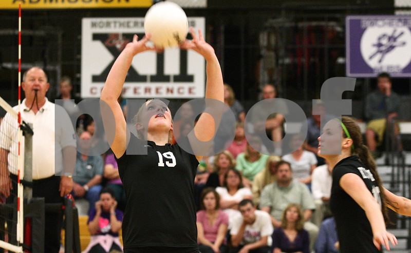 Kyle Bursaw – kbursaw@shawmedia.com<br /> <br /> Kaneland's Ashley Prost sets the ball during the match at Sycamore High School on Tuesday, Sept. 20, 2011.