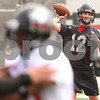 Kyle Bursaw – kbursaw@daily-chronicle.com<br /> <br /> Quarterback Chandler Harnish throws a short pass as another receiver (foreground) blocks during practice at Huskie Stadium on Saturday, April 9, 2011.
