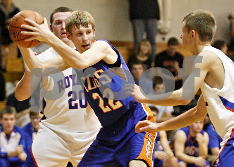Rob Winner – rwinner@shawmedia.com<br /> <br /> Genoa-Kingston's Andrew Oplt (22) controls a rebound under the Royals' basket during the second quarter in Hinckley, Ill., on Monday, Dec. 19, 2011. H-BR defeated G-K, 58-40.
