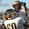 Rob Winner – rwinner@shawmedia.com<br /> <br /> Sycamore's Matt Copple (60) lifts running back Austin Culton after a touchdown run in the second quarter of a Class 5A playoff game in Chicago on Saturday, October 29, 2011. Sycamore defeated King, 36-29.