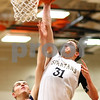 Kyle Bursaw – kbursaw@shawmedia.com<br /> <br /> Sycamore's Tom Paulson dunks over Sterling's Patrick Petrosky during second quarter of their match in the Chuck Dayton Holiday Tournament at DeKalb High School on Friday, Dec. 23, 2011. Sterling defeated Sycamore 61-41.