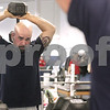 Kyle Bursaw – kbursaw@daily-chronicle.com<br /> <br /> Josh Corn lifts weights at the Kishwaukee YMCA on Friday, Dec. 31, 2010. Corn said he's lost 173 pounds since Dec. 1, 2009.