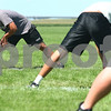Kyle Bursaw – kbursaw@daily-chronicle.com<br /> <br /> Kaneland football players stretch at the start of practice on Thursday, Aug. 11, 2011.