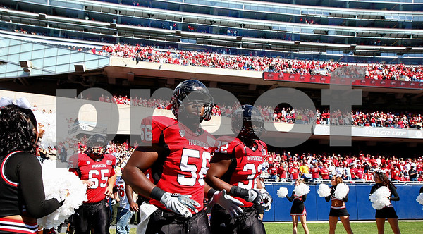 Kyle Bursaw – kbursaw@shawmedia.com<br /> <br /> Northern Illinois defensive end Daniel Green (56) and Northern Illinois fullback Cameron Bell (32) run onto Soldier Field for their game against Wisconsin in Chicago, Ill. on Saturday, September 17, 2011. Wisconsin defeated Northern Illinois 49-7.