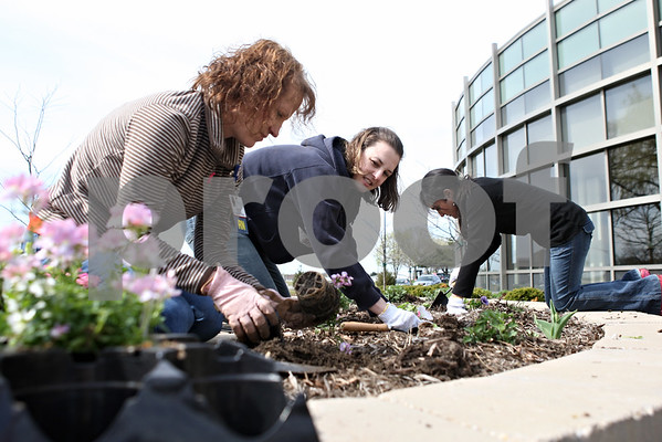 Rob Winner – rwinner@daily-chronicle.com<br /> <br /> Kim Aldis (from left to right), Julie Burtch and Nidhie Singh tend to a flowerbed at the Cancer Center at Kishwaukee Hospital in DeKalb on Monday afternoon.