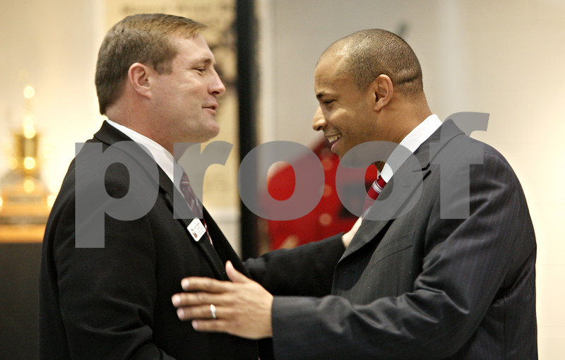 Rob Winner – rwinner@daily-chronicle.com<br /> <br /> Northern Illinois University athletic director Jeff Compher shakes hands with new NIU basketball coach Mark Montgomery at the Convocation Center in DeKalb, Ill., on Monday, March 28, 2011.
