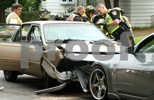 Kyle Bursaw – kbursaw@daily-chronicle.com<br /> <br /> Rescuers work to remove the last injured person from a car accident on Fourth Street just north of Taylor Street on Wednesday, June 15, 2011.