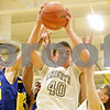 Rob Winner – rwinner@daily-chronicle.com<br /> <br /> Kaneland's Daniel Helm (40) controls a rebound under the Knights' basket during the second quarter of an IHSA Class 3A Sycamore Regional semifinal game on Wednesday, March 2, 2011.