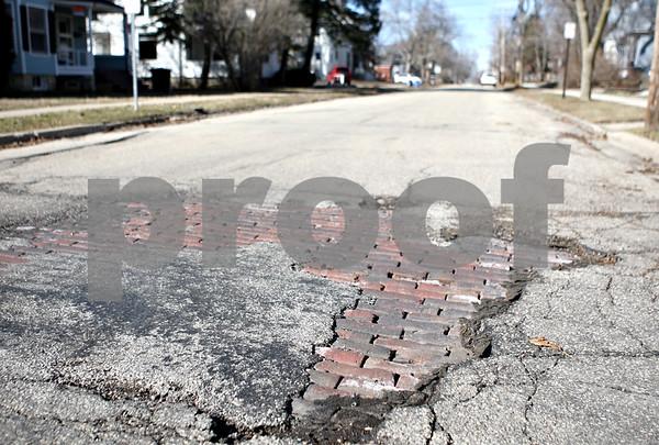 Rob Winner – rwinner@daily-chronicle.com<br /> <br /> Bricks are exposed on Park Avenue near Locust Street in DeKalb, Ill., on Friday, March 11, 2011.