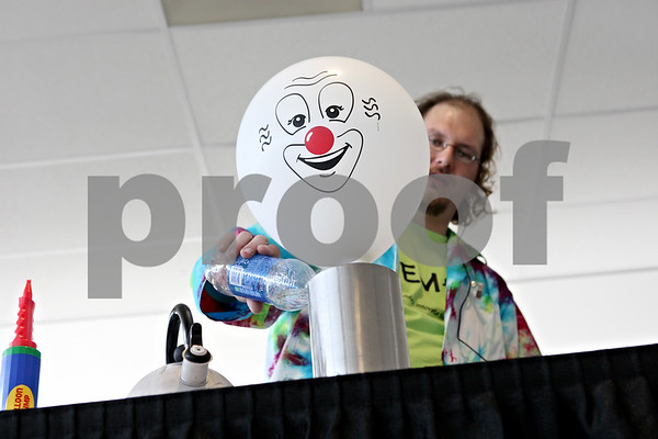 Rob Winner – rwinner@shawmedia.com<br /> <br /> Jeremy Benson uses liquid nitrogen to blow up a balloon during a demonstration at STEMfest at the Convocation Center at Northern Illinois University in DeKalb on Saturday, Oct. 22, 2011. STEMfest seeks to increase public awareness of science, technology, engineering, and math (STEM) initiatives, activities, careers, and education for the people of northern Illinois.