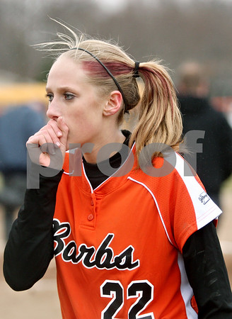 Rob Winner – rwinner@daily-chronicle.com<br /> <br /> DeKalb pitcher Kaylin Kennedy heads to the dugout after the top of the second inning in DeKalb, Ill., on Wednesday, March 23, 2011. DeKalb went on to defeat Indian Creek in five innings, 16-4.