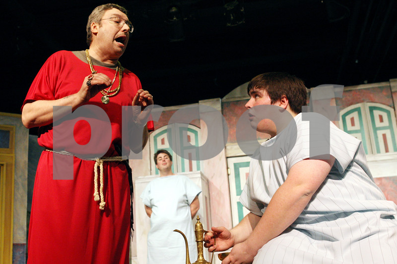 """Rob Winner – rwinner@daily-chronicle.com<br /> <br /> Cast members Lawrence Nepodahl (from left to right), Aaron Moorman and Ryan Morton rehearse a scene from """"A Funny Thing Happened on the Way to the Forum"""" on Wednesday, March 16, 2011 at Stage Coach Players in DeKalb, Ill."""