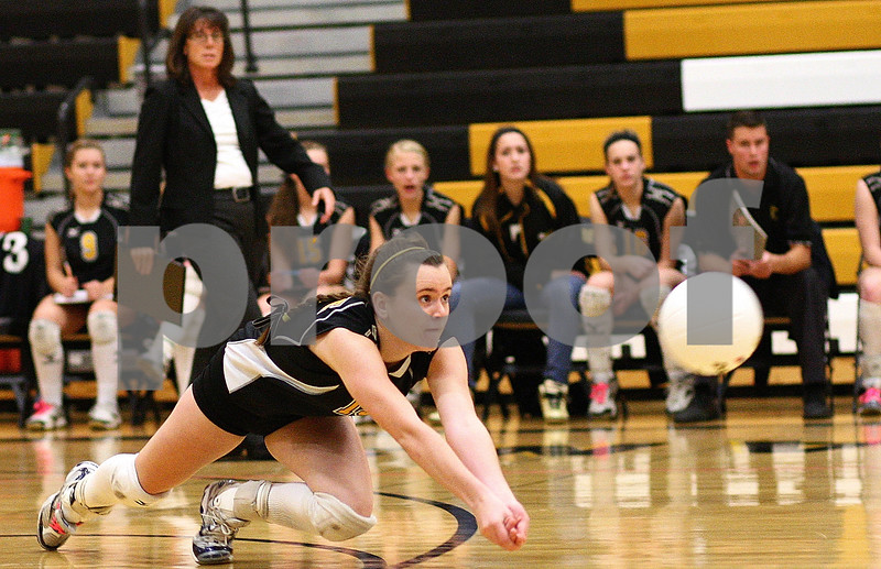 Kyle Bursaw – kbursaw@shawmedia.com<br /> <br /> Sycamore's Shannon Maher dives for the ball during 3A Sycamore Regional Final match against Crystal Lake Central at Sycamore High School on Thursday, Oct. 27, 2011.