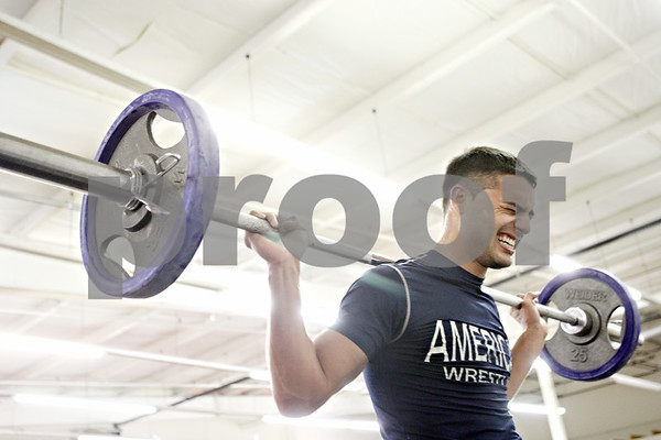 """Rob Winner – rwinner@daily-chronicle.com<br /> <br /> Mike """"Drama"""" Ryan does his circuit training routine, which includes lifting, on Tuesday night at United Mixed Martial Arts and Fitness in DeKalb."""