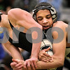 Kyle Bursaw – kbursaw@daily-chronicle.com<br /> <br /> Sycamore's Chris Kerwin escape Kaneland's Esai Ponce at Sycamore High School on Saturday, Feb. 5, 2011. Kerwin defeated Ponce to take first place at 119 pounds in the regional tournament.