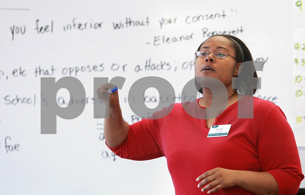 Kyle Bursaw – kbursaw@daily-chronicle.com<br /> <br /> Kim Green, one of two teachers that leads 'Our Place' at Kishwaukee College, starts the class off discussing an inspirational quote from Eleanor Roosevelt before diving into the lesson on Wednesday, Jan. 26, 2011. Our Place is a program for young adults between the ages of 16 and 21 who have dropped out of high school.