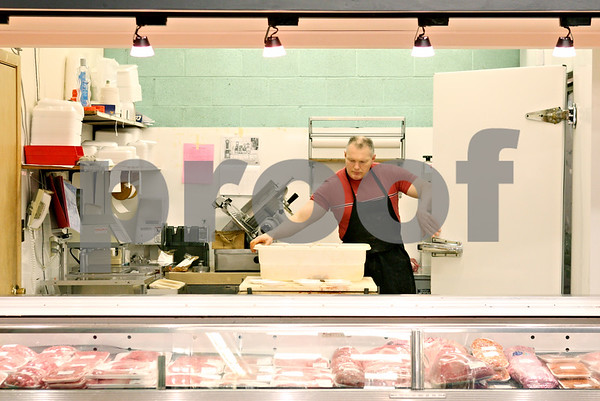 Rob Winner – rwinner@daily-chronicle.com<br /> <br /> Randy Holle, of Wisted's Country Market in Shabbona, works behind the meat counter while making sausage on Tuesday afternoon.