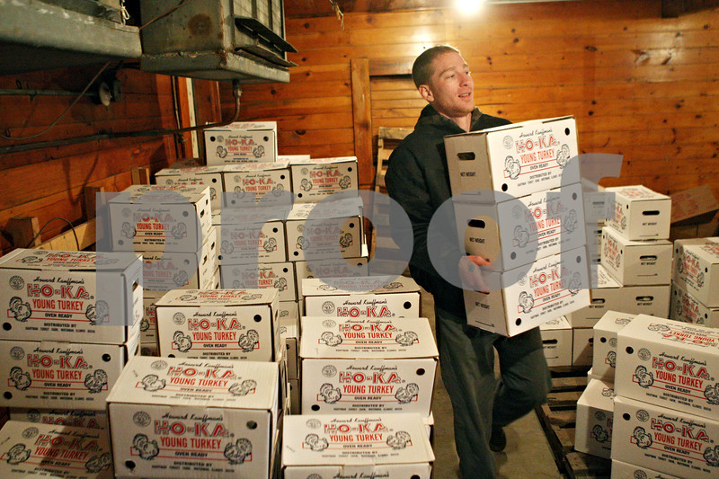 Rob Winner – rwinner@shawmedia.com<br /> <br /> Timothy J. Riffell, an employee at Kaufmann Turkey Farms, gathers an order of Ho-Ka turkeys for a customer from a freezer on Tuesday afternoon in Waterman.