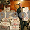 Rob Winner – rwinner@shawmedia.com<br /> <br /> Timothy J. Riffell, an employee at Kaufmann Turkey Farms, gathers an order of Ho-Ka turkeys for a customer from a freezer on Tuesday afternoon in Waterman.