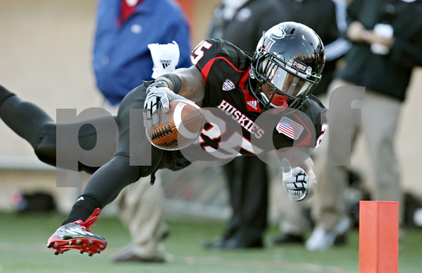 Rob Winner – rwinner@shawmedia.com<br /> <br /> Northern Illinois running back Jasmin Hopkins (25) reaches for the pylon after a 24-yard run during the third quarter in DeKalb, Ill., on Saturday, Oct. 15, 2011. Hopkins was ruled down at the three yard line. Northern Illinois defeated Western Michigan, 51-22.