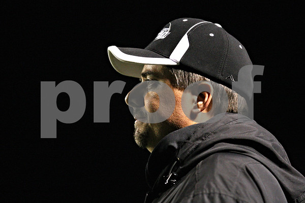 Rob Winner – rwinner@shawmedia.com<br /> <br /> Kaneland coach Tom Fedderly watches his offense line up during the first quarter in Maple Park on Friday, Oct. 28, 2011.