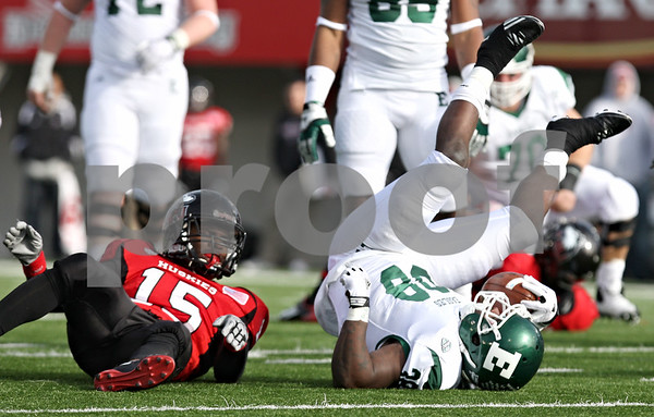 Rob Winner – rwinner@shawmedia.com<br /> <br /> Northern Illinois defensive back Jimmie Ward (15) tackles Eastern Michigan running back Dominique White (38) after a gain of seven yards during the second quarter in DeKalb, Ill., on Friday, Nov. 25, 2011. Northern Illinois defeated Eastern Michigan, 18-12.