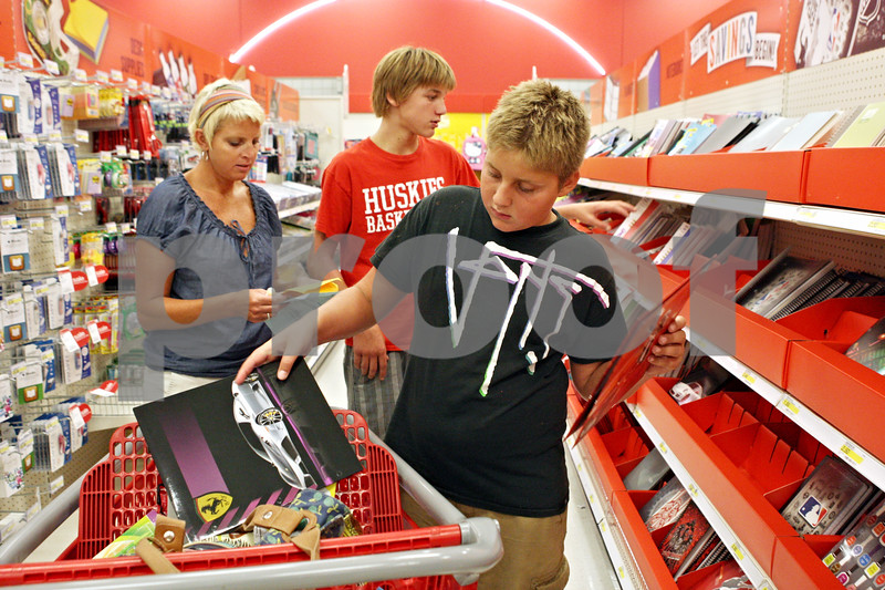 Rob Winner – rwinner@daily-chronicle.com<br /> <br /> Sycamore resident Sherrie Larkins (from left to right) took her two boys Jonnah, 13, and Luke, 10, shopping for back to school supplies at Target in DeKalb on Monday afternoon.