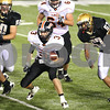 Kyle Bursaw – kbursaw@shawmedia.com<br /> <br /> DeKalb's Kevin Sullivan (3) looks for a place to run as Sycamore's Sam Capello(57) chases him down in the third quarter of their annual matchup at Huskie Stadium on Friday, Sept. 9, 2011.