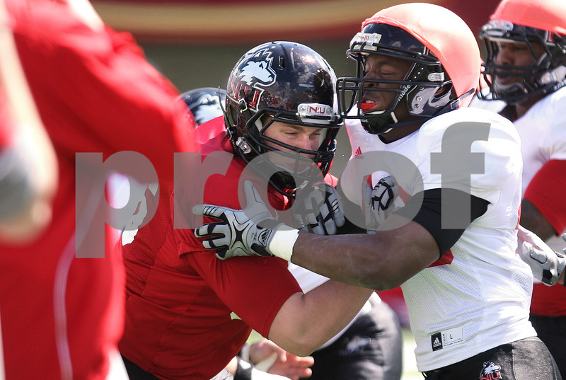 Kyle Bursaw – kbursaw@daily-chronicle.com<br /> <br /> Antione Kirkland (right) and another NIU player battle at the line while practicing special teams plays during practice at Huskie Stadium on Saturday, April 2, 2011.