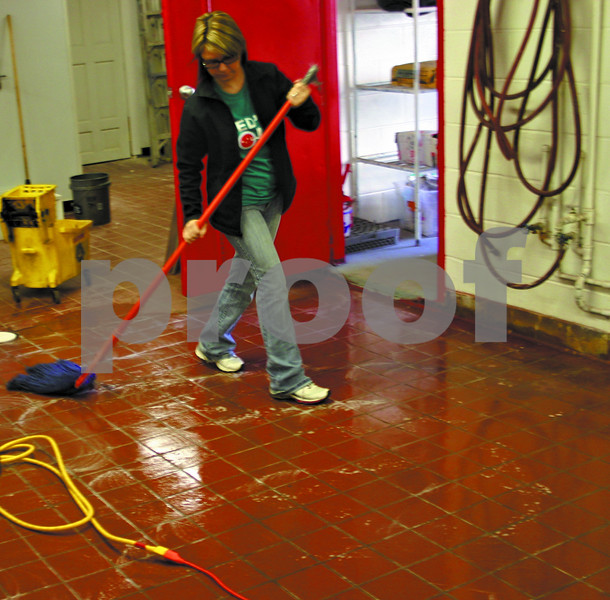 Jeff Engelhardt – Feed'em Soup secretary Samantha Hunt mops the floor of the group's new kitchen Monday in preparation for Wednesday's meal. The group moved to 122 S. First St. to meet the growing demand for its biweekly meals, which are open to the public at no charge.