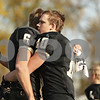 Rob Winner – rwinner@shawmedia.com<br /> <br /> Sycamore's Ryan Bartels (6) and Jordan Kalk (10) embrace after their Class 5A playoff loss to Rochelle in Sycamore, Ill., on Saturday, Nov. 5, 2011. Rochelle defeated Sycamore, 21-16.