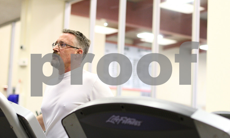 Kyle Bursaw – kbursaw@shawmedia.com<br /> <br /> Rick Burchell runs on one of the treadmills in Kishwaukee YMCA's new Wellness Center inside of Huntley Middle School on Friday, Dec. 23, 2011. The site had a soft open for YMCA members who live in DeKalb and teachers on Dec. 16. The facility will officially open to all members on January 2, 2012.