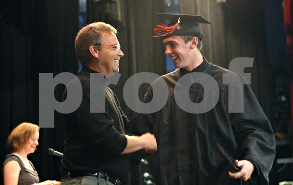Rob Winner – rwinner@daily-chronicle.com<br /> <br /> Dan Sanderson (left) congratulates his son, Seth Sanderson, during the Indian Creek High School commencement on Sunday, May 15, 2011, in Shabbona, Ill.