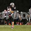 Rob Winner – rwinner@shawmedia.com<br /> <br /> Kaneland receiver Ryan Fuchs (10) hauls in a pass during the second quarter in Maple Park, Ill., on Friday, Oct. 7, 2011.