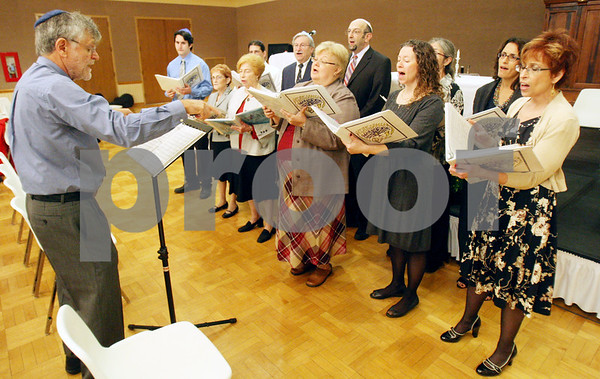 Rob Winner – rwinner@shawmedia.com<br /> <br /> Members of the choir practice before a Rosh Hashanah service at Northern Illinois University Holmes Student Center in DeKalb on Wednesday night.